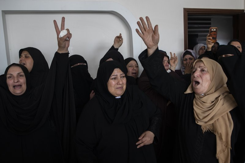 Relatives of Islamic Jihad commander, Bahaa Abu el-Atta, who was killed with his wife by an Israeli missile strike on their home, mourn during the funeral in Gaza City, Tuesday, Nov. 12, 2019. (AP Photo/Khalil Hamra)