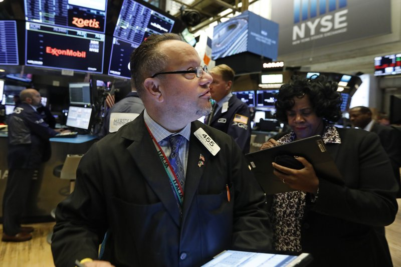 Trader Robert Arciero works on the floor of the New York Stock Exchange, Tuesday, Nov. 12, 2019. Stocks are opening slightly higher on Wall Street, led by gains in technology and health care companies. (AP Photo/Richard Drew)