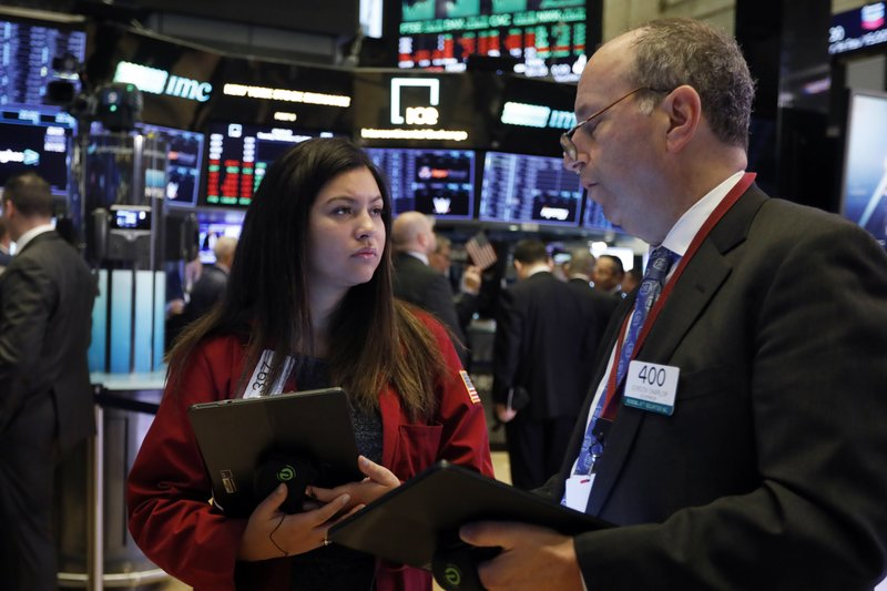 Traders Ashley Lara and Gordon Charlop work on the floor of the New York Stock Exchange, Tuesday, Nov. 12, 2019. Stocks are opening slightly higher on Wall Street, led by gains in technology and health care companies. (AP Photo/Richard Drew)