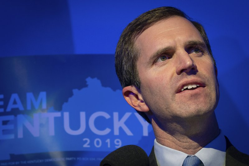 FILE - In this Nov. 5, 2019, file photo, Democratic gubernatorial candidate and Kentucky Attorney General Andy Beshear speaks at the Kentucky Democratic Party election night watch event in Louisville, Ky. Republican Gov. Matt Bevin could face a legacy-defining decision once a recanvass of the Kentucky vote count is completed Thursday, Nov. 14. He can concede to Beshear or contest last week's election and potentially put the outcome in the hands of lawmakers. (AP Photo/Bryan Woolston, File)
