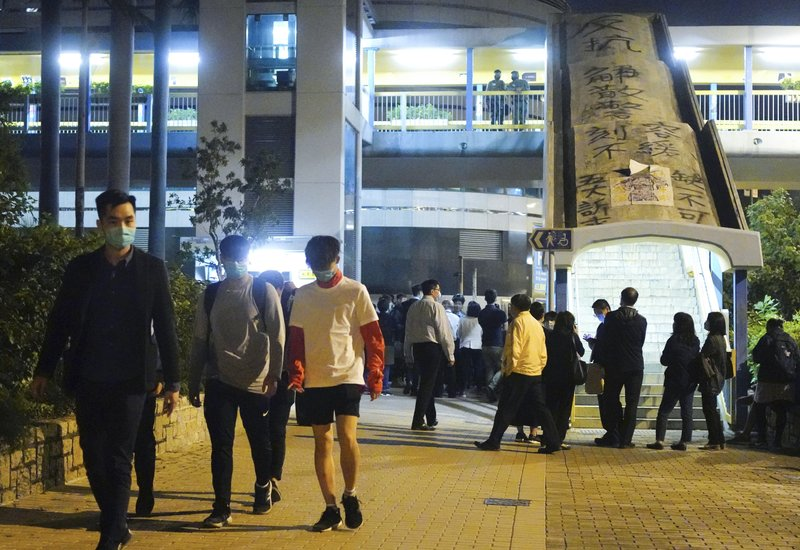 Students under 18 walk after being released from Hong Kong Polytechnic University campus in Hung Hom district, Hong Kong, Monday, Nov. 18, 2019.  Police tightened their siege of a university campus where hundreds of protesters remained trapped Monday night in the latest dramatic episode in months of protests against growing Chinese control over the semi-autonomous city. (AP Photo/Vincent Yu)