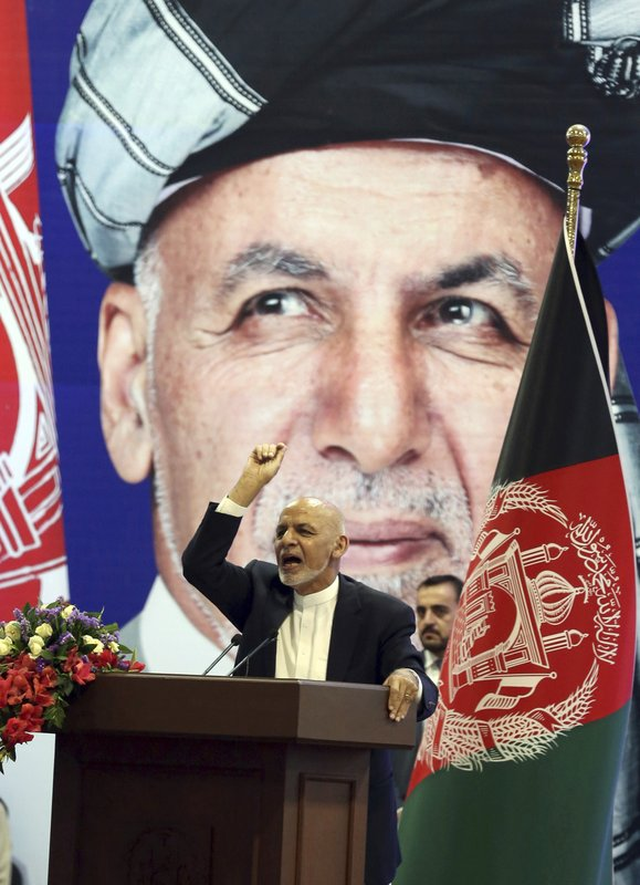 FILE - In this July 28, 2019, photo, then Afghan presidential candidate Ashraf Ghani speaks during the first day of campaigning in Kabul, Afghanistan. Taliban officials have told The Associated Press that three Taliban prisoners released by Kabul have been flown to Qatar for a swap for an American and an Australian hostage held by the insurgents. The three Taliban prisoners were to have been freed more than one week ago by Afghan President Ashraf Ghani. (AP Photo/Rahmat Gul, File)