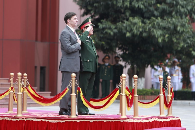 U.S. Defense Secretary Mark Esper and Vietnamese Defense Minister Ngo Xuan Lich stand for national anthems during a welcome ceremony in Hanoi, Vietnam Wednesday, Nov. 20, 2019. Esper is on a visit to Vietnam to strengthen the military relations with the Southeast Asian nation. (AP Photo/Hau Dinh)
