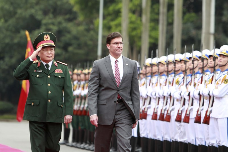 U.S. SDefense Secretary Mark Esper, right, and Vietnamese Defense Minister Ngo Xuan Lich review an honor guard in Hanoi, Vietnam on Wednesday, Nov. 20, 2019. Esper is on a visit to Vietnam to strengthen the military relations with the Southeast Asian nation. (AP Photo/Hau Dinh)
