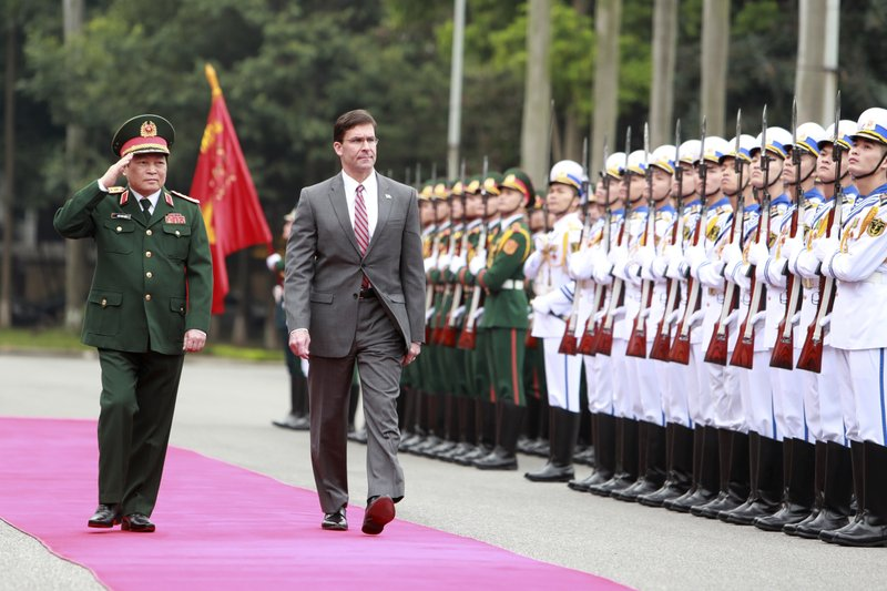 U.S. Defense Secretary Mark Esper, center, and Vietnamese Defense Minister Ngo Xuan Lich review an honor guard in Hanoi, Vietnam Wednesday, Nov. 20, 2019. Esper is on a visit to Vietnam to strengthen the military relations with the Southeast Asian nation. (AP Photo/Hau Dinh)