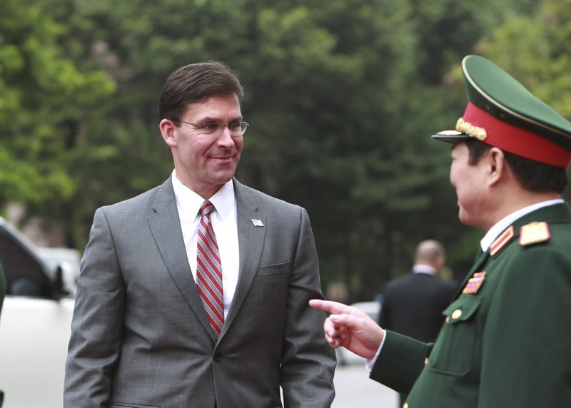 U.S. Defense Secretary Mark Esper, left, and Vietnamese Defense Minister Ngo Xuan Lich talk before a meeting in Hanoi, Vietnam Wednesday, Nov. 20, 2019. Esper is on a visit to Vietnam to strengthen the military relations with the Southeast Asian nation. (AP Photo/Hau Dinh)