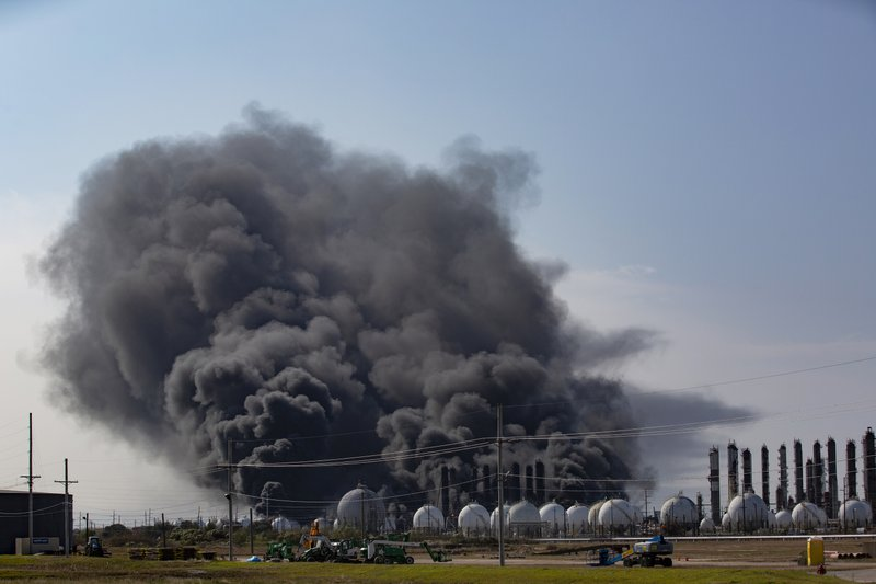 Smoke rises from an explosion at the TPC Group Port Neches Operations plant on Wednesday, Nov. 27, 2019, in Port Neches, Texas. (Marie D. De Jesus/Houston Chronicle via AP)