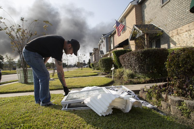 Brian Kessel observes his broken windows on Wednesday, Nov. 27, 2019, in Port Neches, Texas. Kessel's windows got shattered by an explosion at the TPC Group chemical plant. He said he is unharmed. (Marie D. De Jesús/Houston Chronicle via AP)