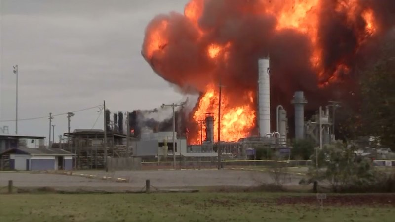 While firefighters battled a large refinery fire on Wednesday afternoon at a Texas chemical plant that was spurred by an earlier explosion, a large fireball erupted and sent large plumes of black smoke into the air. (Nov. 27)