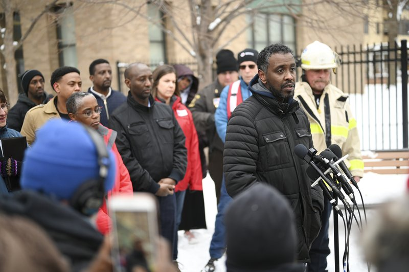 Minneapolis City Councilman Abdi Warsame addresses the media outside the building at 630 Cedar Avenue  where an early morning fire killed multiple people Wednesday, Nov. 27, 2019 in Minneapolis. Residents of the high rise were evacuated early Wednesday after a fire broke out on the 14th floor of the building.  (Aaron Lavinsky/Star Tribune via AP)