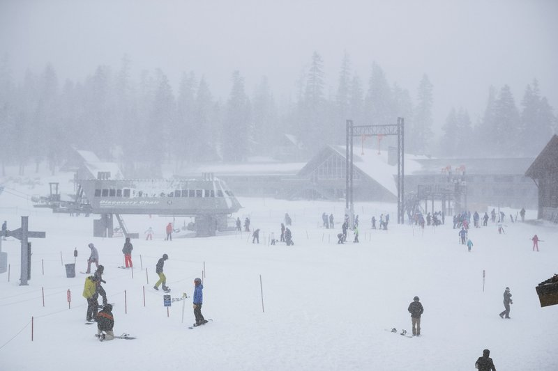 This Tuesday, Nov. 27, 2019 photo provided by the Mammoth Mountain Ski Area shows heavy snow fall at Mammoth Mountain Ski Area in Mammoth Mountain, Calif. Blizzard conditions have closed Interstate 5 south of Ashland, Oregon, all the way to the California state line. The Siskiyou Summit at the border on I-5, typically one of the more perilous sections of freeway along the West Coast corridor in wintery weather, had seen 6 inches of new snow with 10 inches packed on the roadside. (Peter Morning/Mammoth Mountain Ski Area via AP)