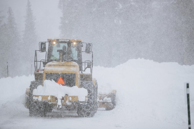 This Tuesday, Nov. 27, 2019 photo provided by the Mammoth Mountain Ski Area shows a Caterpillar snow plow clearing a road at Mammoth Mountain Ski Area resort in Mammoth Mountain, Calif. Blizzard conditions have closed Interstate 5 south of Ashland, Oregon, all the way to the California state line. The Siskiyou Summit at the border on I-5, typically one of the more perilous sections of freeway along the West Coast corridor in wintery weather, had seen 6 inches of new snow with 10 inches packed on the roadside. (Peter Morning/Mammoth Mountain Ski Area via AP)