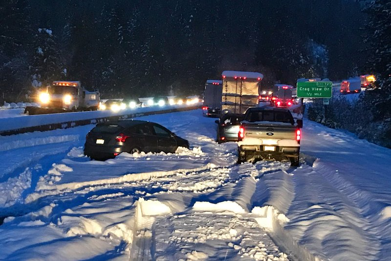 In this photo taken Tuesday, Nov. 26, 2019, provided by Caltrans, are cars and trucks in stopped traffic on Interstate 5 near Dunsmuir, Calif. A