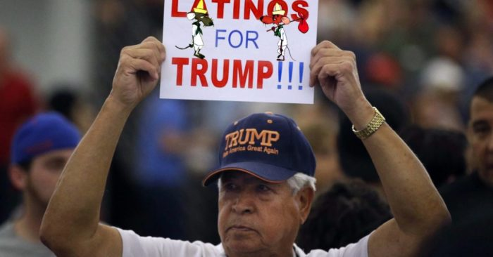 A man holds a sign in support of President Trump at a 2016 rally. (AP/Jae C. Hong, File)