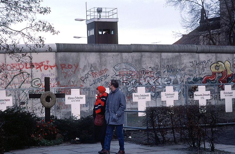 Symbolic funeral crosses in honor of the dead on the wall. Jan. 1990 (Wikimedia Commons).
