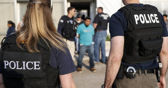 Government agents arrest a suspect during an immigration operation at the Flores Center on June 5, 2018, in Castalia, Ohio. (Photo AP/John Minchillo)