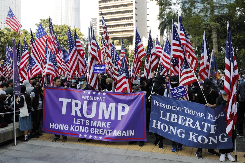 Protesters prepare to march to U.S. Consulate during a rally in Hong Kong, Sunday, Dec. 1, 2019. Hong Kong protesters carrying American flags and banners appealing to President Donald Trump are rallying in the semi-autonomous Chinese territory. (AP Photo/Vincent Thian)