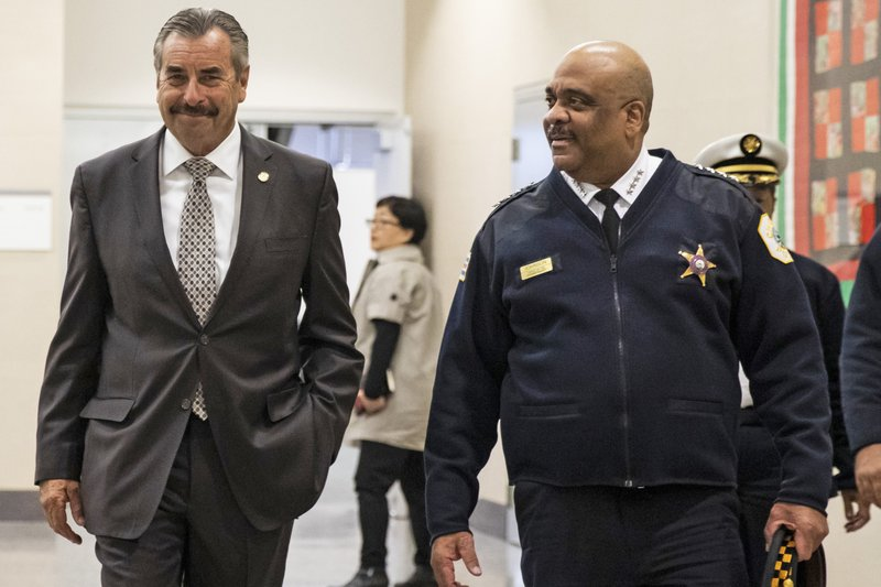 FILE - In this Nov. 8, 2019 file photo, Chicago's interim Police Superintendent Charlie Beck, left, walks through CPD headquarters with retiring Police Superintendent Eddie Johnson, in Chicago. Chicago Mayor Lori Lightfoot fired Police Supt. Eddie Johnson on Monday, Dec. 2, 2019, saying her decision was based his