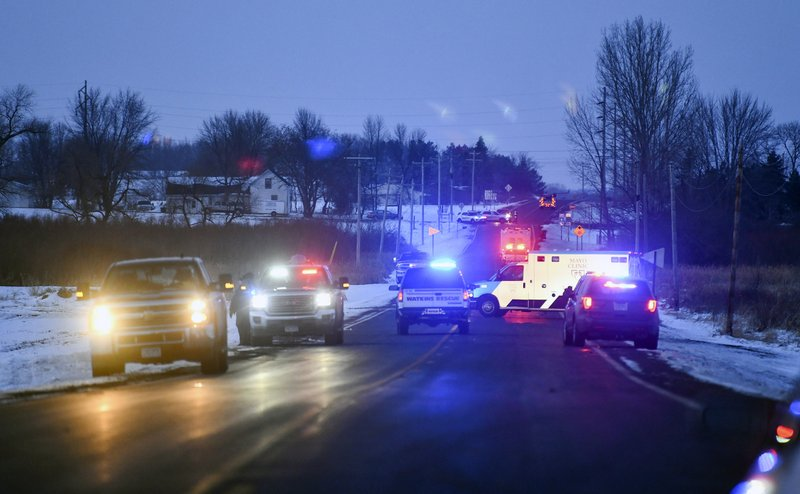 Emergency vehicles line the road near the scene of a helicopter crash Thursday, Dec. 5, 2019, near Marty, Minn. A Black Hawk helicopter with three crew members aboard crashed Thursday in central Minnesota, a state National Guard official said. (Dave Schwarz/St. Cloud Times via AP)