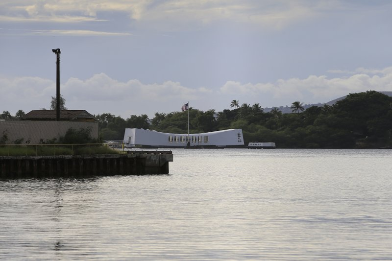 The USS Arizona Memorial can be seen from the Pearl Harbor National Memorial Wednesday, Dec. 4, 2019, in Honolulu. A U.S. sailor shot and wounded several civilian Department of Defense employees at the Pearl Harbor shipyard Wednesday before taking their own life, the military said. The shipyard is across the harbor from the Pearl Harbor National Memorial. (AP Photo/Marco Garcia)