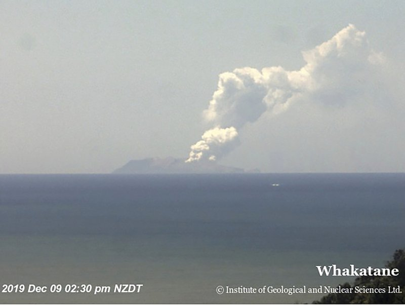 This image released by GNS Science, shows plumes of smoke from a volcanic eruption on White Island, seen from Whakatane, New Zealand Monday, Dec. 9, 2019. A volcano erupted Monday on a small New Zealand island frequented by tourists, and a number of people were missing and injured after the eruption. (GNS Science via AP)