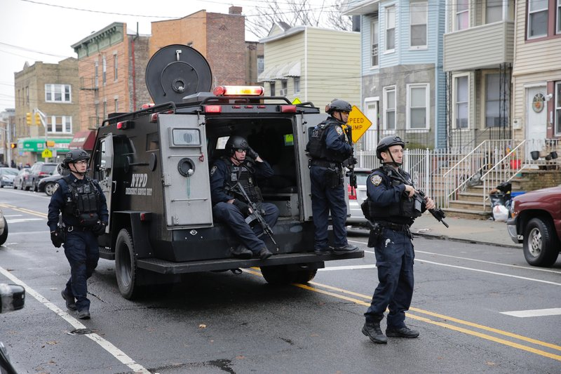 New York City Police officers arrive on the scene following reports of gunfire, Tuesday, Dec. 10, 2019, in Jersey City, N.J.  (AP Photo/Seth Wenig)