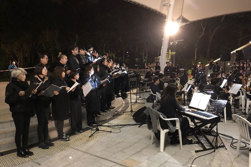 In this Tuesday, Dec. 10, 2019 photo, a theater troupe performs Les Miserables in at an outdoor event space in Hong Kong. A Hong Kong theater troupe is making audiences weep by touring a stirring production of 'Les Miserables.' Based on Victor Hugo's tale of rebellion in 19th-century France, the rousing music and lyrics of struggle and resistance struck chords with audience members emotionally and physically drained after six months of protests that have convulsed the city. (AP Photo/John Leicester)
