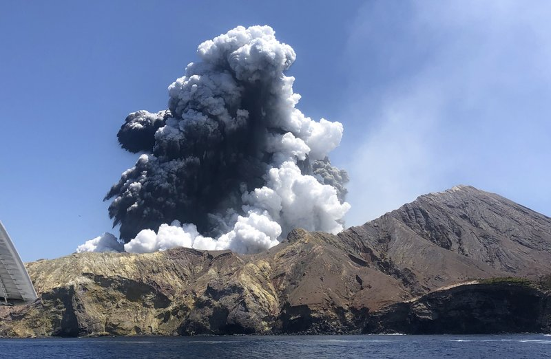In this Monday, Dec. 9, 2019, photo provided by Lillani Hopkins, shows the eruption of the volcano on White Island off the coast of Whakatane, New Zealand. Lillani Hopkins was feeling seasick and keeping her eyes trained on the open water as her tour boat swung around for a last view of the White Island volcano on Monday afternoon, Dec 9, 2019. Suddenly people started gasping and then her dad whacked her, telling her to turn around. The eruption had been so silent she hadn't heard it over the noise of the boat's engines. (Lillani Hopkins via AP)