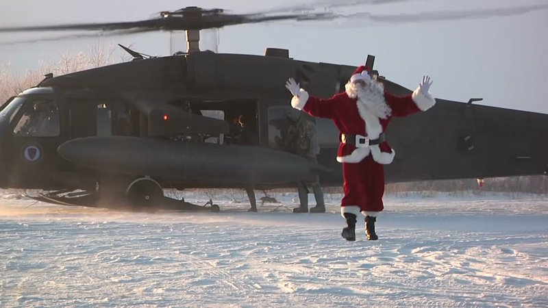 Members of the Alaska Air National Guard flew to a rural village recently with a special mission, delivering some early Christmas cheer and a visit from Santa Claus to schoolchildren and their families. (Dec. 11)