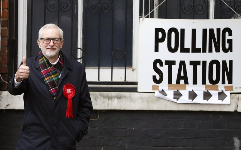 British opposition Labour Party leader Jeremy Corbyn, gestures after casting his vote in the general election, in Islington, London, England, Thursday, Dec. 12, 2019 .U.K. voters are deciding Thursday who they want to resolve the stalemate over Brexit in a parliamentary election widely seen as one of the most decisive in modern times. (AP Photo/Thanassis Stavrakis)