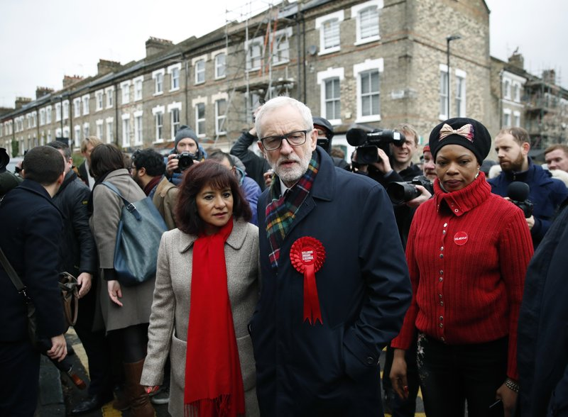 British opposition Labour Party leader Jeremy Corbyn, centre right and his wife Laura Alvarez leave after voting in the general election in Islington in Islington, London, England, Thursday, Dec. 12, 2019 .U.K. voters are deciding Thursday who they want to resolve the stalemate over Brexit in a parliamentary election widely seen as one of the most decisive in modern times. (AP Photo/Thanassis Stavrakis)