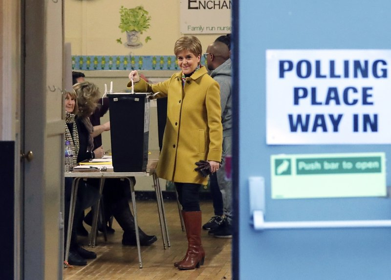 Scottish First Minister Nicola Sturgeon casts her vote in Glasgow, Scotland, Thursday, Dec. 12, 2019. U.K. voters are voting Thursday for who they want to resolve the stalemate over Brexit in a parliamentary election widely seen as one of the most decisive in modern times. (AP Photo/Scott Heppell)