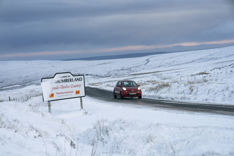 A covering of snow in Northumberland, northeast England, Thursday Dec. 12, 2019.  Some districts are predicting a low turnout for today's general election due to winter conditions, after the first snow of the season. (Owen Humphreys/PA via AP)