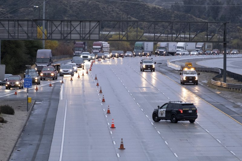 Traffic on the northbound side of the I-5 freeway is diverted off at Parker road in Castaic, Calif., as snow on the Grapevine has made the road impassable Thursday, December 26, 2019. The CHP had no estimate as to when the freeway would re-open. (David Crane/The Orange County Register via AP)