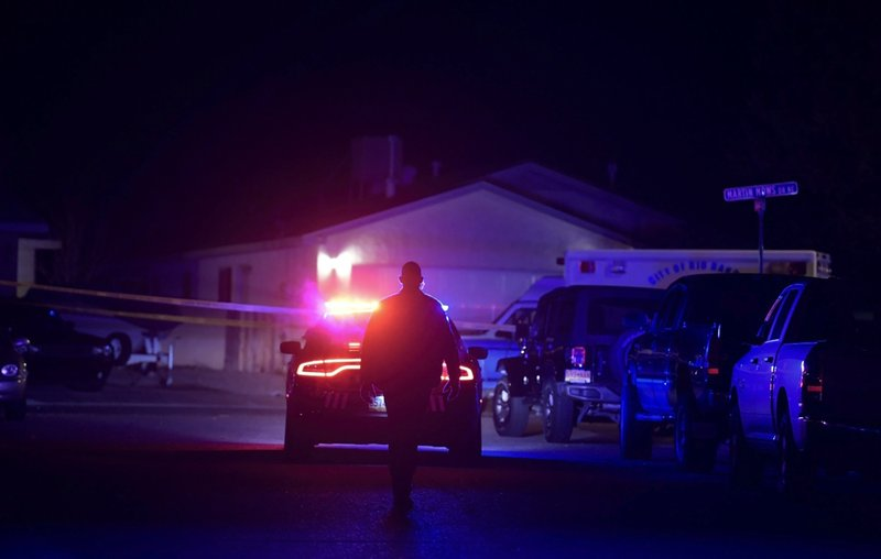 Authorities work the scene where multiple people were found dead in a home in the Northern Meadows subdivision, Wednesday, Dec. 25, 2019, in Rio Rancho, N.M. (Roberto E. Rosales/The Albuquerque Journal via AP)