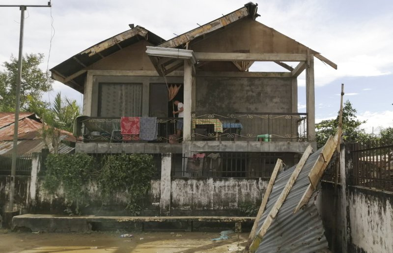 A resident checks his home damaged by Typhoon Phanfone in Ormoc city, central Philippines on Thursday Dec. 26, 2019. The typhoon left over a dozen dead and many homeless. (AP Photo)
