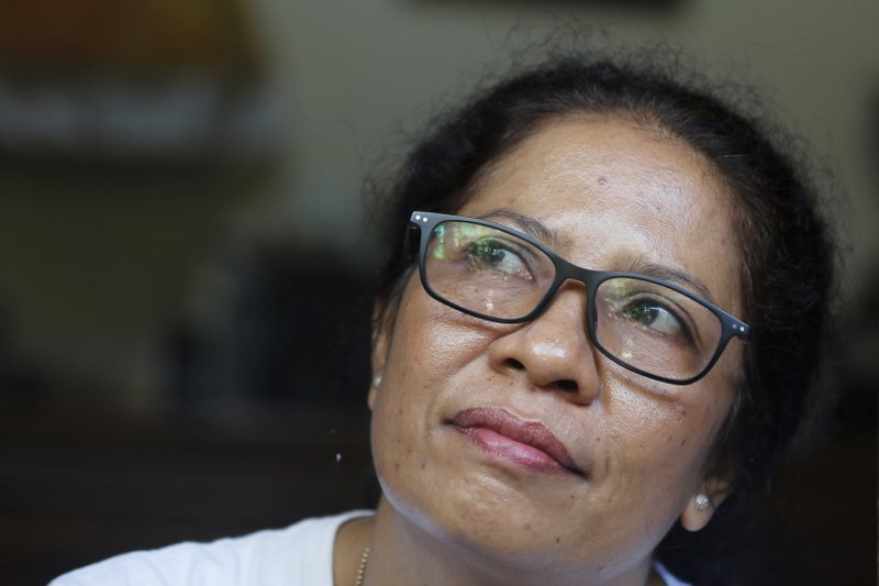 Ni Luh Erniati sits in her home in Bali, Indonesia on Friday, April 26, 2019. Erniati's husband, Gede Badrawan, was one of 202 people killed in the 2002 Bali bombings. For years after the bombings, she was consumed by rage toward the perpetrators, but has since reconciled with a former bombmaker whose brothers helped orchestrate the attack as part of a peacebuilding program bringing together ex-terrorists and victims. (AP Photo/Firdia Lisnawati)