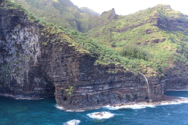 This photo provided by the Hawaii department of Land and Natural Resources shows an area over Napali Coast State Wilderness Park where search and rescue are searching for a tour Helicopter that disappeared in Hawaii with several people aboard on Friday, Dec. 27, 2019. Authorities say the helicopter's owner called for help about 45 minutes after the chopper was due back from a tour of Kauai's Na Pali Coast on Thursday evening. (Dan Dennison/Hawaii DLNR via AP)