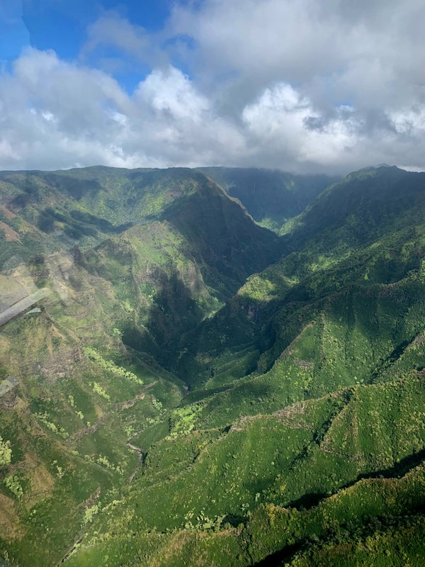 This Dec. 17, 2019, aerial photo shows the Na Pali Coast on the island of Kauai in Hawaii. The Coast Guard is searching for a tour helicopter that disappeared on the Na Pali Coast with seven people aboard on Thursday, Dec. 26, 2019. Authorities say the helicopter's owner called for help about 45 minutes after the chopper was due back from the tour. (AP Photo/Maryclaire Dale)