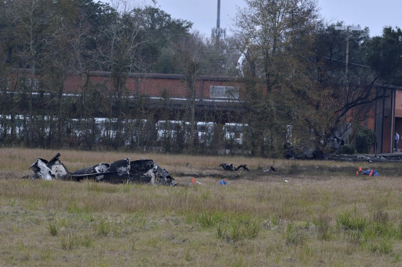 A view of the burnt wreckage of a plane crash near Feu Follet Road and Verot School Road in Lafayette, La., Saturday, Dec. 28, 2019.  Authorities confirmed the accident but details on whether anyone was injured was not immediately known.(Scott Clause/The Lafayette Advertiser via AP)