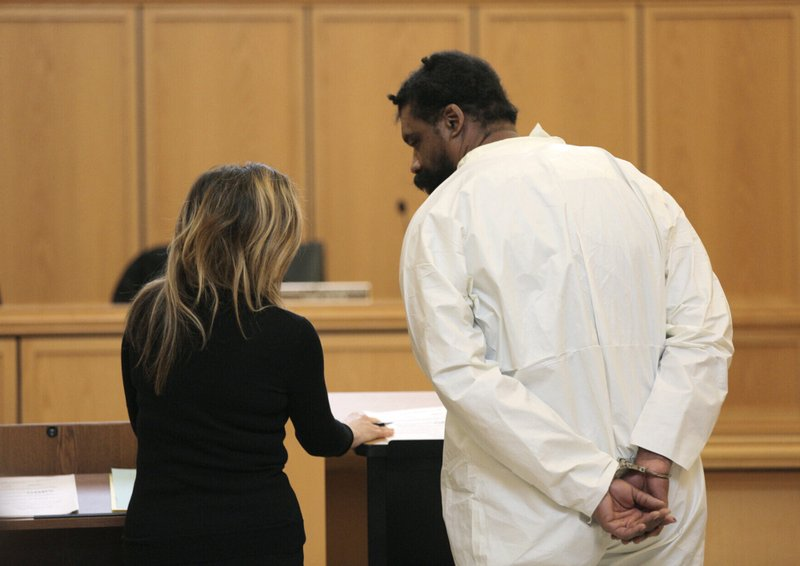 Grafton Thomas, right, appears for his arraignment at Ramapo Town Hall in Ramapo, N.Y., on Sunday, Dec. 29, 2019. Thomas is accused of stabbing multiple people as they gathered to celebrate Hanukkah at a rabbi's home in an Orthodox Jewish community north of New York City. (AP Photo/Julius Constantine Motal)