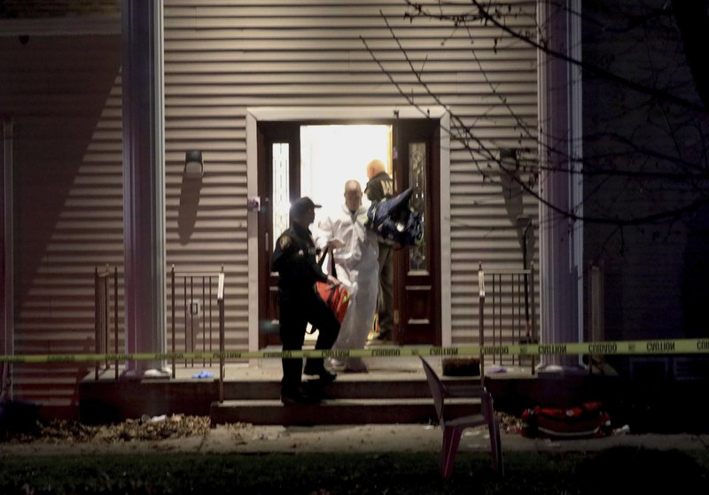 Police work at a residence in Monsey, N.Y., early Sunday, Dec. 29, 2019, following a stabbing Saturday during a Hanukkah celebration. Authorities say that several people were stabbed north of New York City late Saturday night and a possible suspect has been located. The Orthodox Jewish Public Affairs Council for the Hudson Valley region tweeted reports that the stabbing took place at the house of a Hasidic rabbi while they were celebrating Hanukkah. (Seth Harrison/The Journal News via AP)