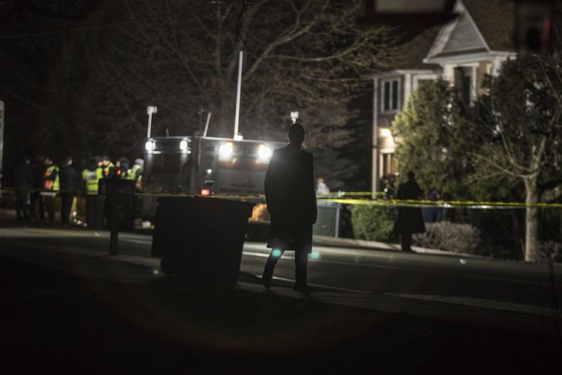 Authorities and first responders gather in front of a residence in Monsey, N.Y., Sunday, Dec. 29, 2019, following a stabbing late Saturday during a Hanukkah celebration. A man attacked the celebration at the rabbi's home north of New York City late Saturday, stabbing and wounding several people before fleeing in a vehicle, police said. (AP Photo/Allyse Pulliam)