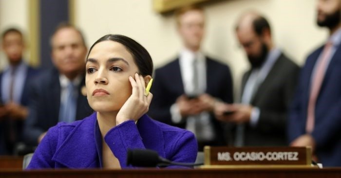 FILE - In this photo from April 10, 2019, Rep. Alexandria Ocasio-Cortez, D-NY, listens during a hearing of the House Financial Services Committee with the leaders of the major banks at Washington's Capitol. (AP Photo/Patrick Semansky, File)