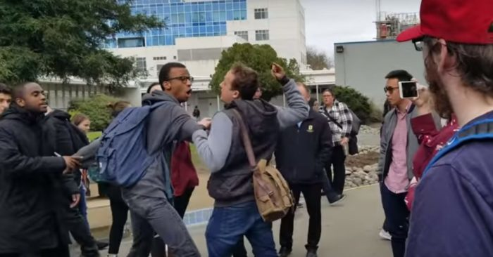 African American Conservative Student Leader Floyd Johnson II stops, in another case, the white student Keaton Hill who assaulted the African American student behind Johnson II. (Screenshot Youtube/Phil Nope)