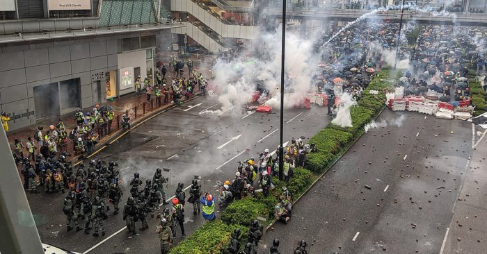 Police use tear gas to suppress the first protests by demonstrators in Hong Kong on 25 August 2019. (Studio Incendo/CC0)
