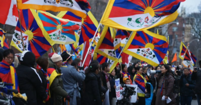 Tibetan activists protest the Chinese regime's library exhibit