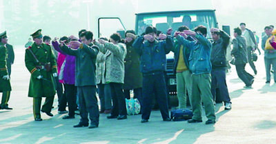 Practitioners exercise at Tiananmen Square
