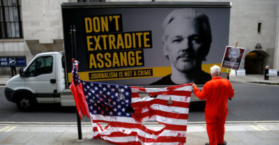 Assange's extradition hearing to the US stopped due to risk of CCP virus