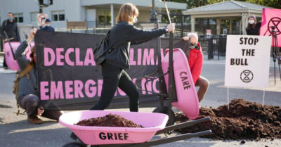 Extinction Rebellion dumps cow manure outside White House in protest against Biden's climate change policy